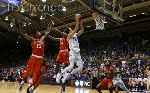 Sophomore Luke Kennard scored 15 straight Blue Devil points in the second half as Duke withstood a furious Clemson rally.