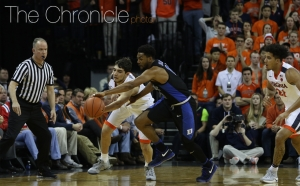 The Blue Devils held Virginia to 5-of-20 shooting from 3-point range and pressured the Cavalier guards into some costly turnovers.