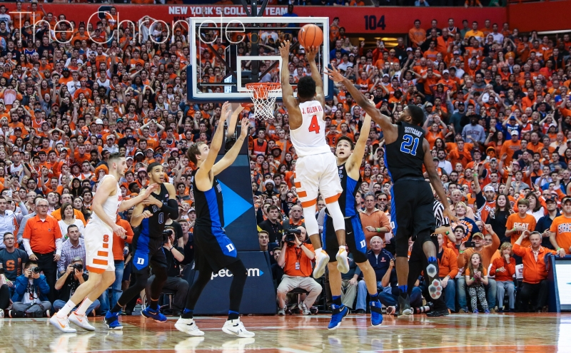 John Gillon raced up the court and banked home a 25-foot 3-pointer to give Syracuse an upset win Wednesday night and end Duke's seven-game winning streak.