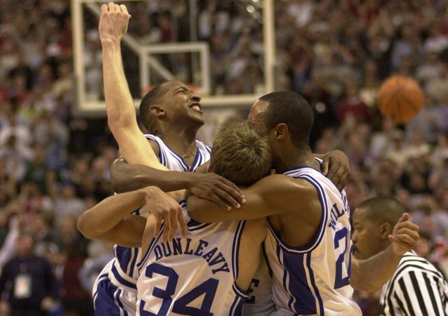 Jay Williams (right) led the Blue Devils on one of the most dominant NCAA tournament runs ever in 2001.