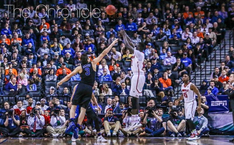 After the Blue Devils switched to their zone defense, Louisville's aggressiveness attacking the basket seemed to disappear.