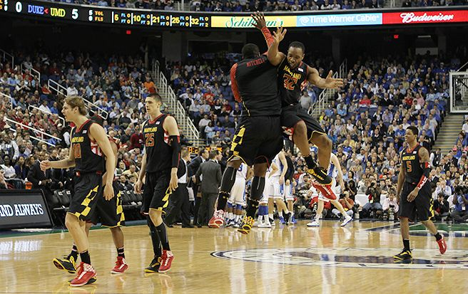 Maryland's Dez Wells, who scored 30 points, celebrates during his team's win over Duke.