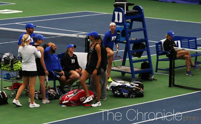 A rain delay of almost two and a half hours interrupted Friday's match between doubles and singles.