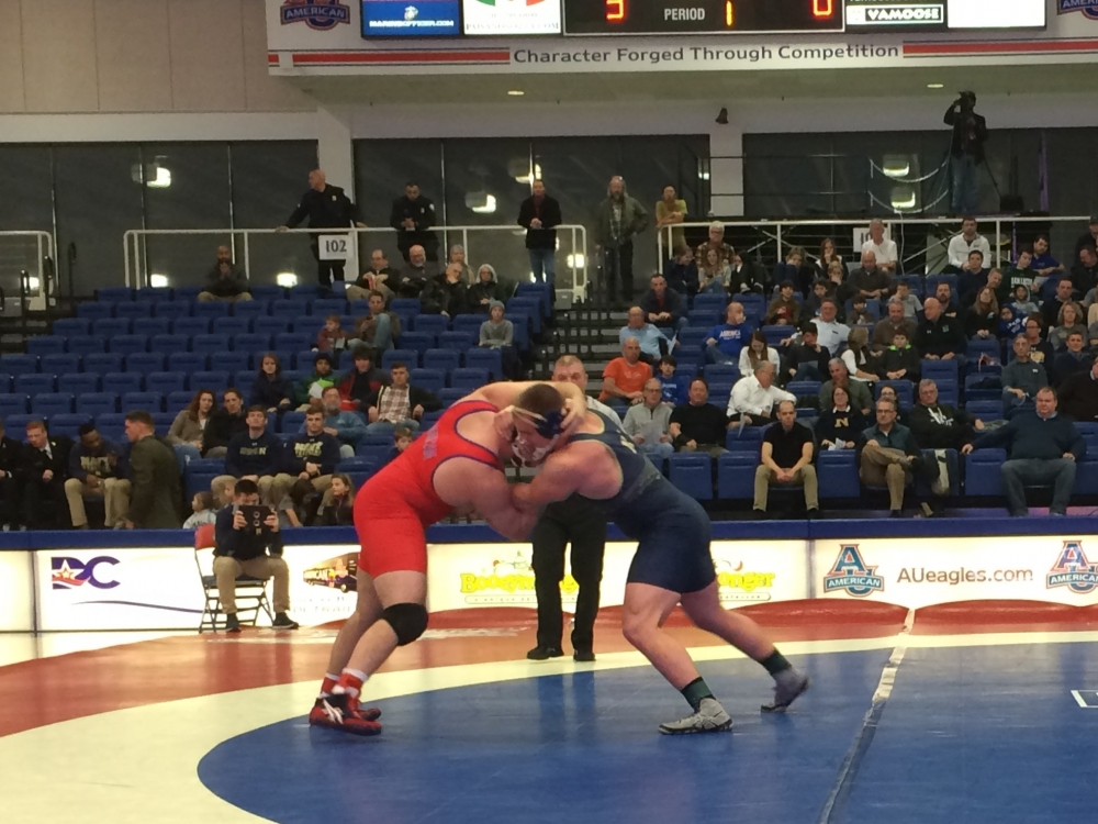 Wrestling falls to Navy in home opener