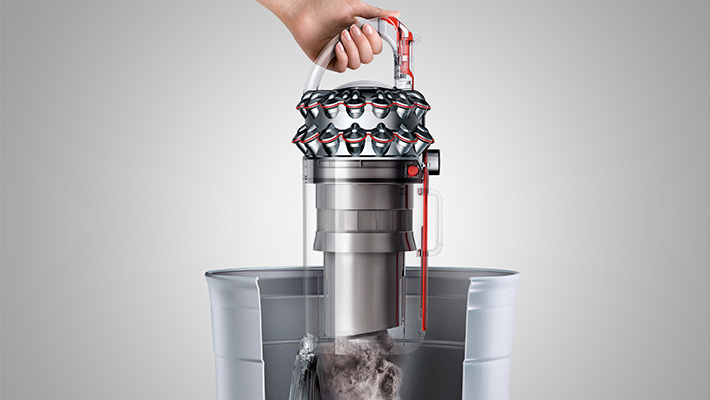 The Dyson Cinetic Big Ball Animal + Allergy upright vacuum cleaner. Hygienic bin emptying - Just push the button to release the dirt.