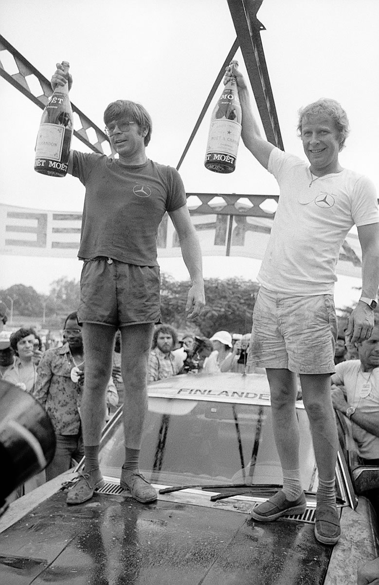 Hannu Mikkola (right) and Arne Hertz after their victory in the 11th Bandama Rally in 1979 with a Mercedes-Benz 450 SLC 5.0 rally car.