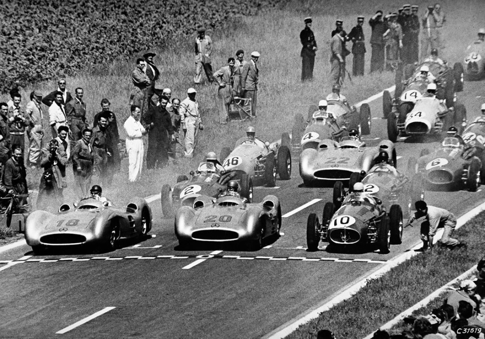 French Grand Prix in Reims, July 4, 1954. At the wheel of streamlined Mercedes-Benz W 196 R racing cars: Juan Manuel Fangio (start number 18), the winner of the race, and Karl Kling (start number 20) who finished in second place. Behind them Hans Herrmann with start number 22.
