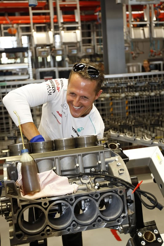 MERCEDES AMG PETRONAS Formula One drivers Michael Schumacher and Nico Rosberg built an AMG engine together with an AMG master mechanic in Affalterbach