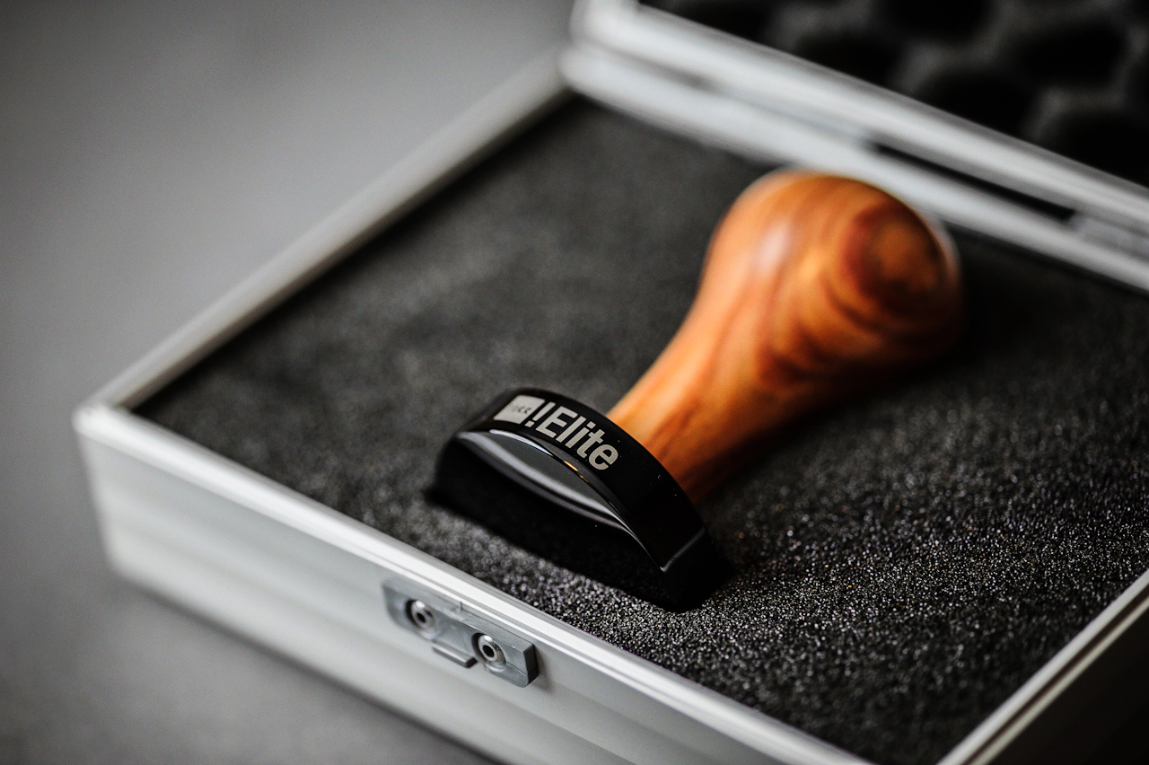 Torr Tamper Rosewood Handle and Black Titanium Piston in case closeup