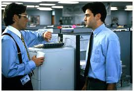Peter (played by Ron Livingston, right) has to deal with his smarmy and callous boss Bill (Gary Cole) in Office Space.