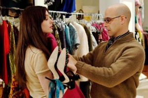 "Art Director Nigel (Stanley Tucci) helps to mentor Emily (Anne Hathaway) in ""The Devil Wears Prada."""