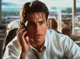 Tom Cruise plays struggling sports agent Jerry Maguire.