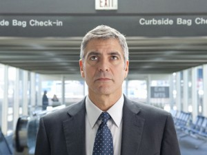 George Clooney plays hired gun corporate layoff expert Ryan Bingham in Up in the Air.