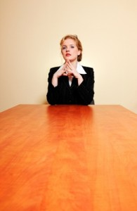 Lone woman at conf table - freedigital