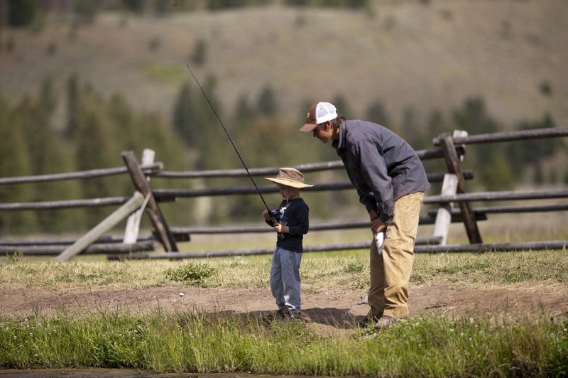 boy_and_gray_fishing_at_pond_2.jpg
