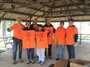 A team from First Congregational Church, Shrewsbury shows off their earth stewardship swag