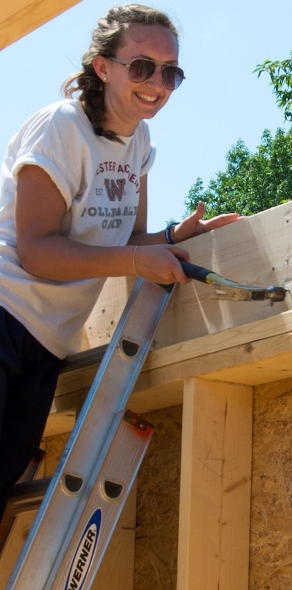 Youth working on a house on the First Church, Shrewsbury, MA mission trip.