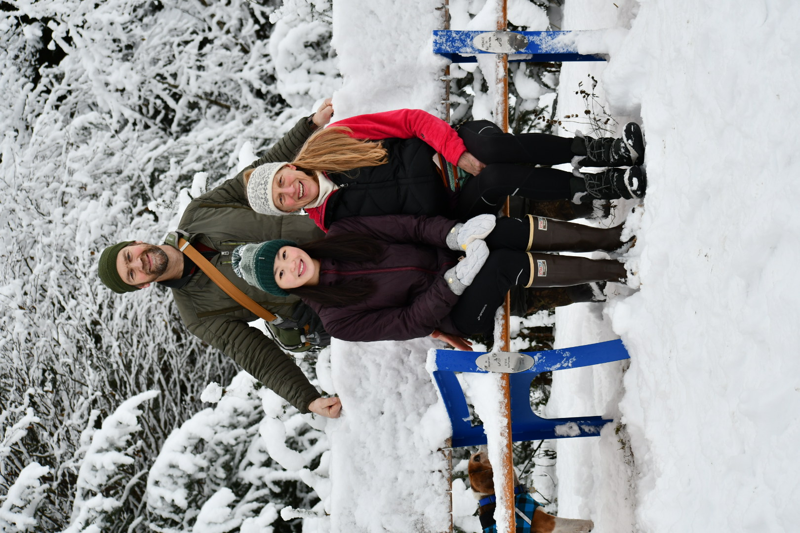 Photo of Pete, Annie and Sara Hagen in a snow covered landscape.