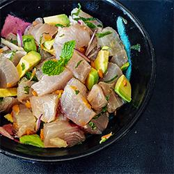 Poke cubed (square cuts) ono fish in a bowl.