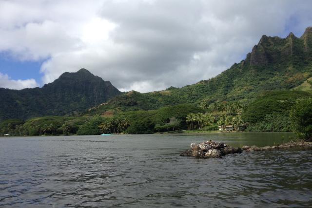 A daytime photo of the Moli`i Fishpond at Kualoa Ranch in Oahu.