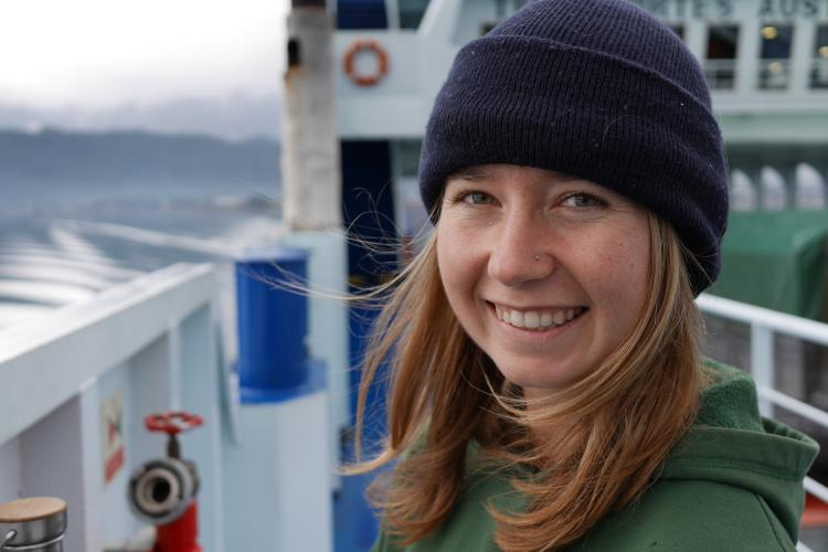 Photo of Dr. Jordan Hollarsmith on a boat deck.