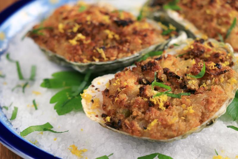 Photo of baked oysters on the half shell.