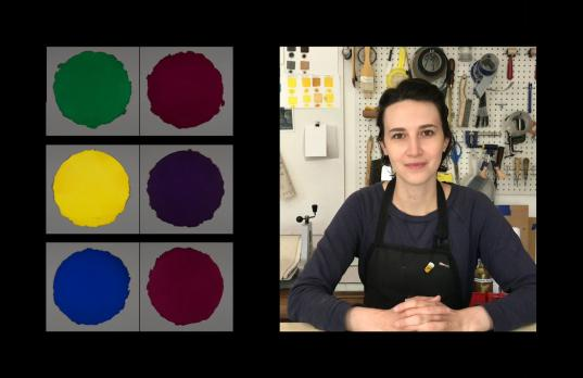A split-screen image shows on the left six prints in a grid-like pattern: three rows include two colored circular prints each on a square gray background. On the right, a young woman wearing a navy sweatshirt and black apron sits at a table with her hands folded, a bulletin board of artist tools behind her.