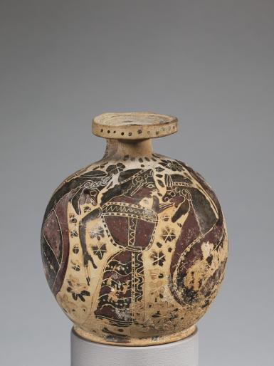This small round clay vessel has a narrow opening at the top and a flat bottom. It is decorated with three figures in dark silhouette over a light background, showing a woman between two bearded sirens. Rosette ornaments fill the space between the figures.
