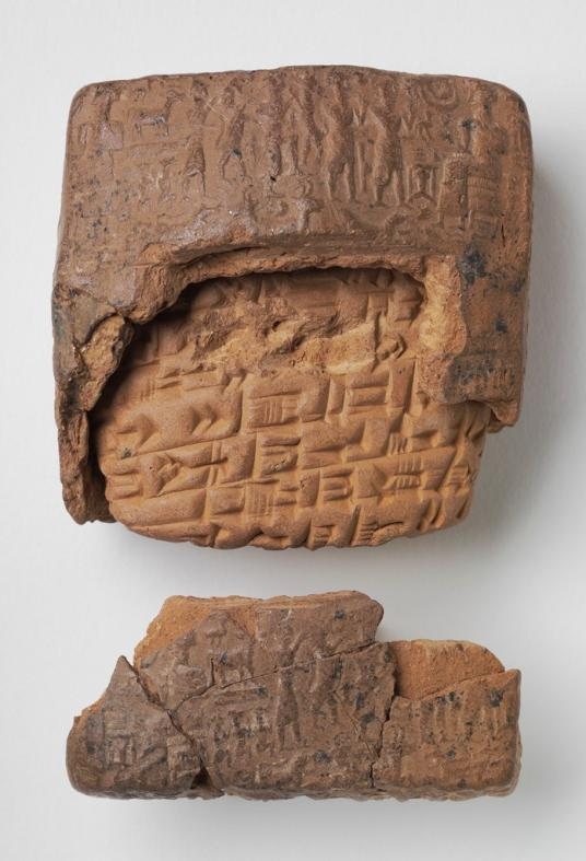 This image shows a clay tablet broken into two pieces. The top and bottom form a sort of case or envelope and are covered with tiny, carved images of people, animals, and symbols. The section in the middle looks like a separate piece with cuneiform writing and is a slightly lighter orange color.
