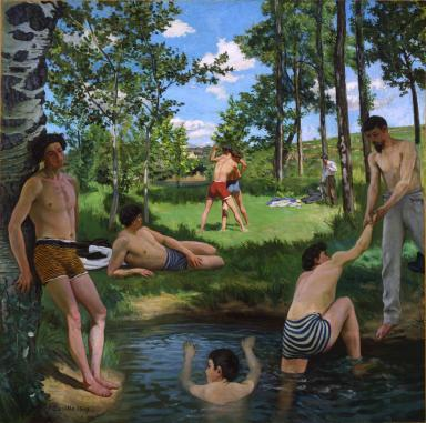 A group of young men gather in and around a watering hole on a sunny day.