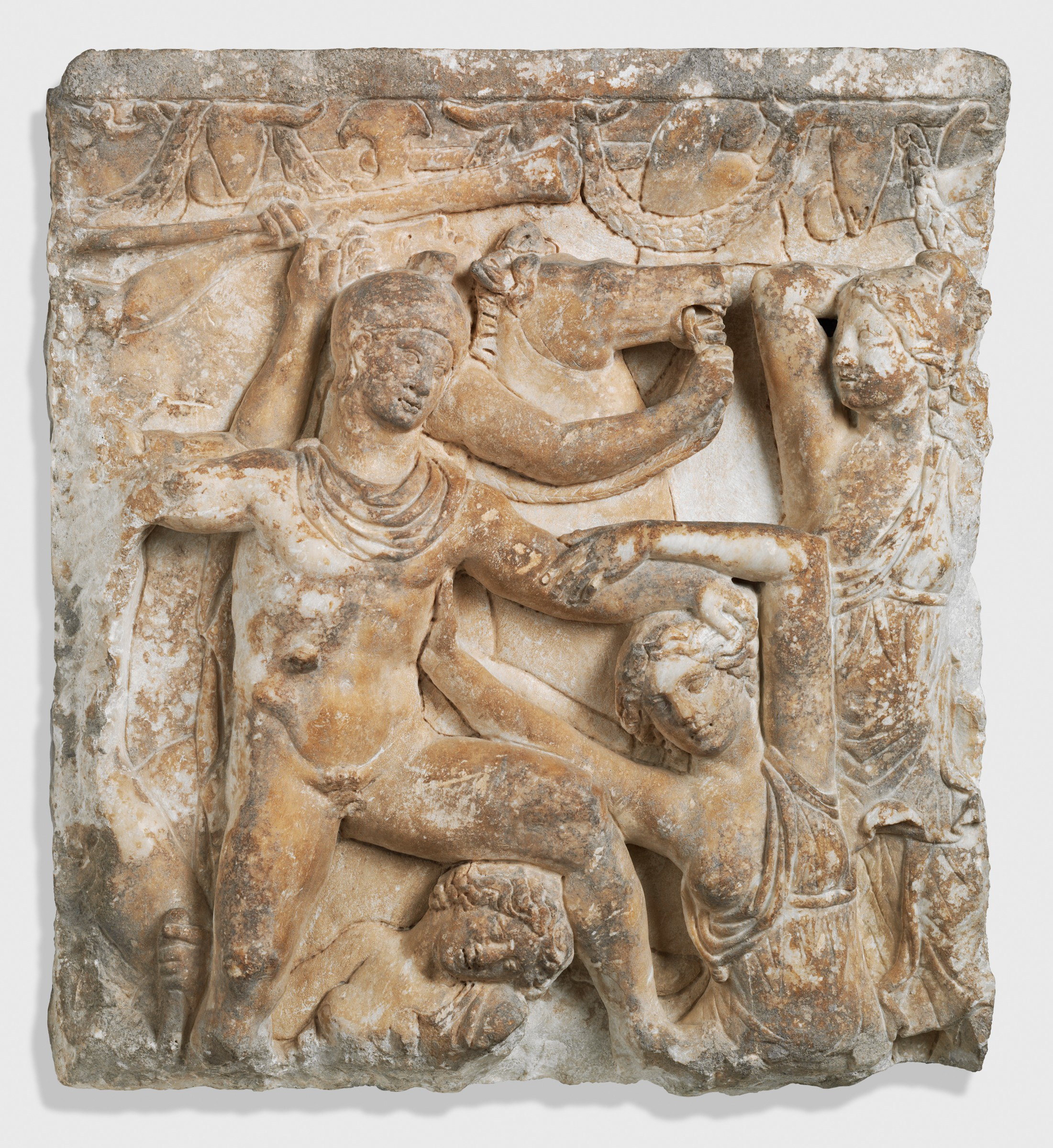 Photograph of a portion of a carved marble sarcophagus depicting Amazon women fighting men.