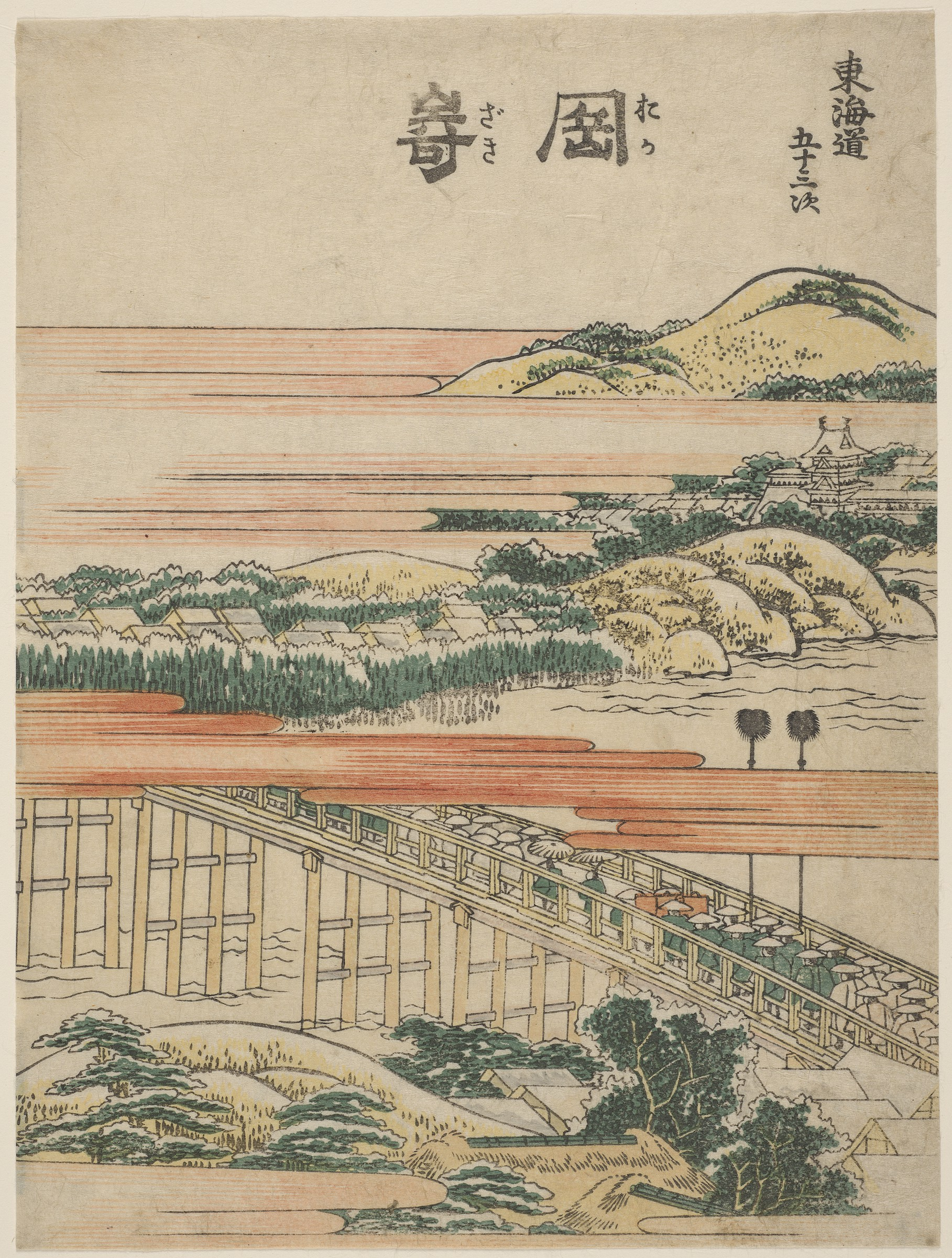 Woodblock print by Katsushika Hokusai of a landscape with mountains, rooftops, and a bridge filled with people.