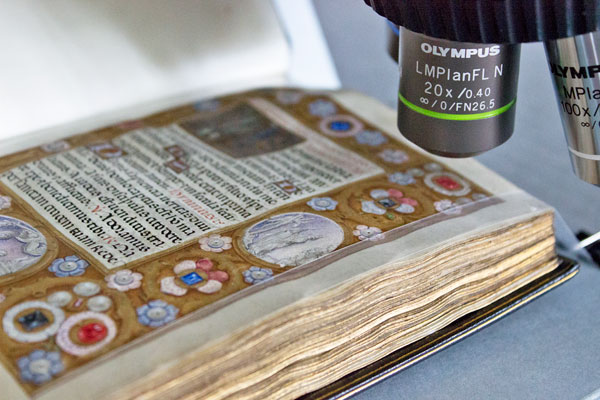 The Book of Hours underneath the Straus Center's Raman spectrometer. Photo: Zak Jensen.