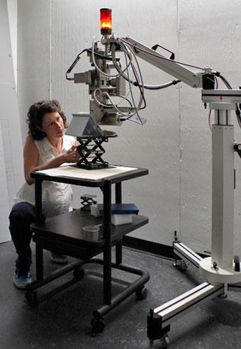 Erin Mysak sets up the Straus Center's X-ray fluorescence spectrometer. Photo: Zak Jensen.