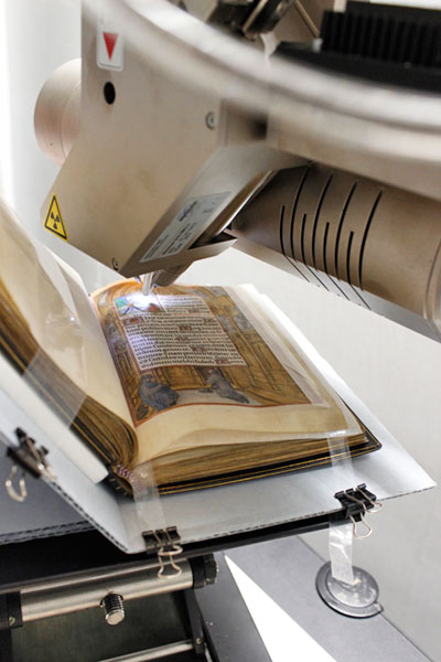 Using the X-ray fluorescence spectrometer for technical analysis of the Book of Hours. Photo: Zak Jensen.