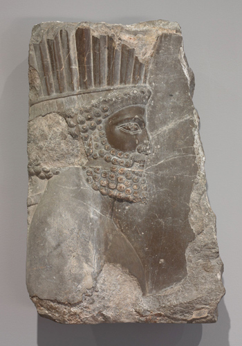Head of an Archer of the Royal Guard, Achaemenid Persian, 486–465 BCE. Limestone relief. Harvard Art Museums/Arthur M. Sackler Museum, Bequest of Grenville L. Winthrop, 1943.1063.