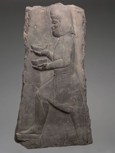 Servant with Bowls, Achaemenid Persian, 500–400 BCE. Limestone relief. Harvard Art Museums/Arthur M. Sackler Museum, Bequest of Grenville L. Winthrop, 1943.1066.
