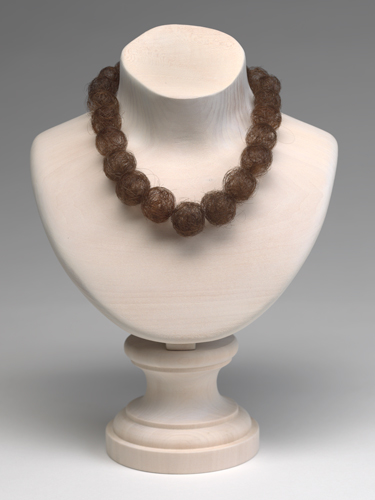 Mona Hatoum, Hair Necklace, 2013. Human hair and wooden bust. Harvard Art Museums/Fogg Museum, Gift of Mr. G. David Thompson, in memory of his son, G. David Thompson, Jr., Class of 1958, by exchange, 2013.16. © Mona Hatoum.