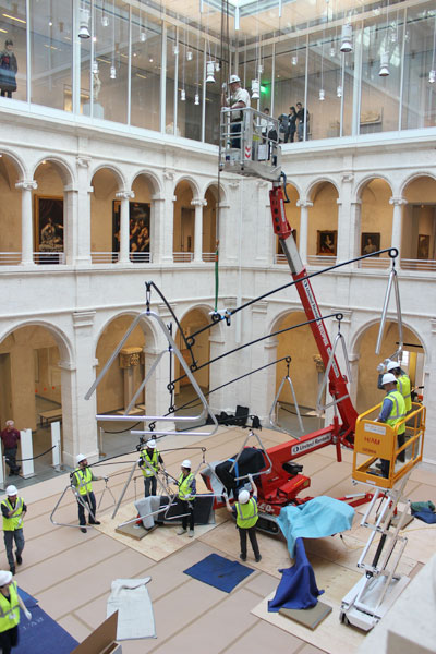 The museums remained open while installers took over the courtyard to hang the 556-pound mobile sculpture.