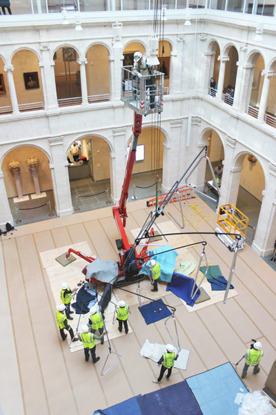 A view of the installation process from high above; there are different vantage points on the sculpture from throughout the museums.