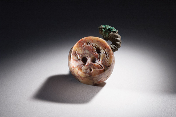 This jasper sealstone, depicting a crouching goat with a tree branch, was found at the site in 2011.