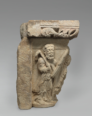 The left face of Capital of Engaged Twin Columns, showing a figure holding a gardening hoe, who may be the gardener for whom Mary Magdalene mistook the risen Christ.