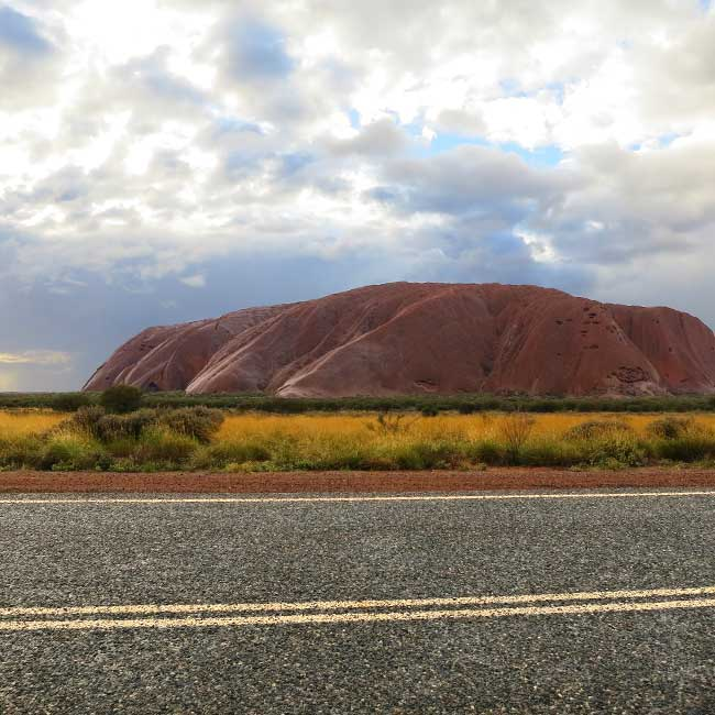 Uluru, also known as Ayers Rock, is located in central Australia. The site is sacred to the Anangu, the indigenous people of the area, and many paintings are found here. Photo: Narayan Khandekar.