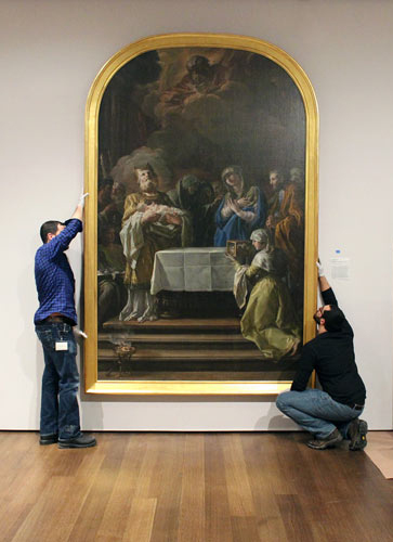 Collections Management staff install Corrado Giaquinto's Presentation in the Temple, c. 1764–65.