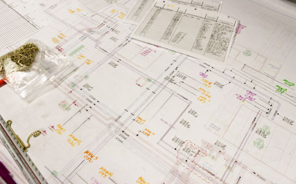 Workers use detailed drawings as well as a 3D computer program to determine where equipment needs to be installed.