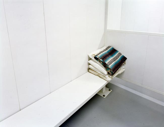 David Taylor, Detention Cell (with serape), New Mexico, 2007. Archival inkjet print. Courtesy of James Kelly Contemporary.