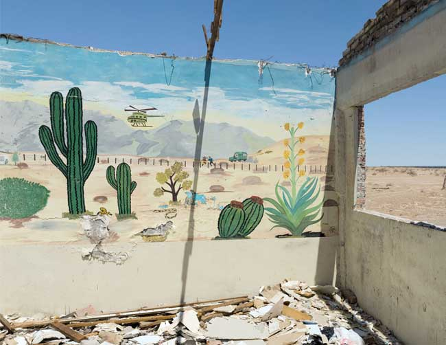 David Taylor, Mural (with border fence), Sonora, 2009–10. Archival inkjet print. Courtesy of James Kelly Contemporary.