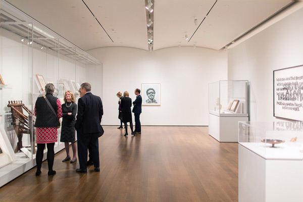 Harvard faculty gather in the University Study Gallery during an opening event last month.