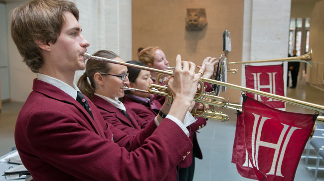 Students in the Harvard University Band greeted the first rounds of visitors with the celebratory sounds of trumpets.
