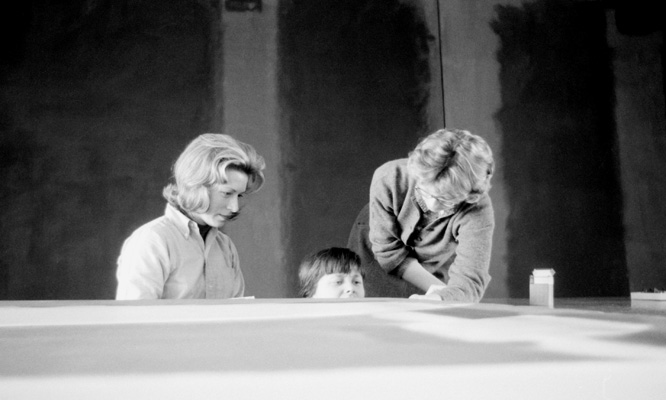 Conservators Jean Lampton (Woodward), Marjorie Cohn, and Sue Ellen Crampton stretch Panel Five, in front of Panel Two and Panel Three of the Harvard Murals, Holyoke Center, January 1963. Photo: Elizabeth H. Jones.
